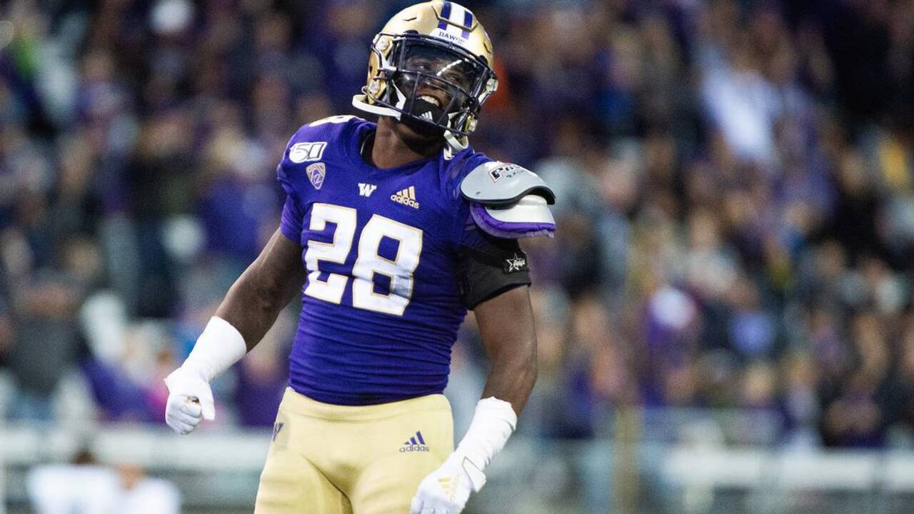 "Huskies running back Richard Newton won't need surgery, considered ""week-to-week"""