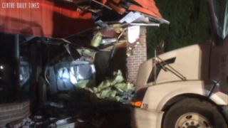 Tractor trailer truck crashes into the side of convenience store
