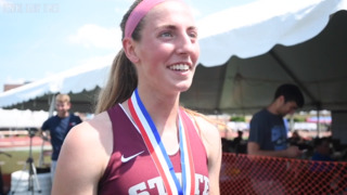 State College's Esther Seeland reacts to her gold medal win in the girls AAA 800 meter run