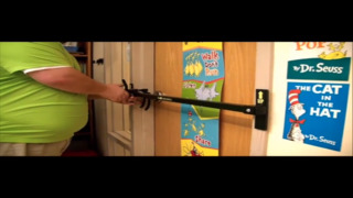 Young Scholars teacher demonstrates security system to prevent intruders in the classroom