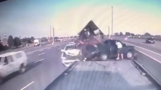Car demolishes truck on side of Canadian highway