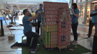 Teams work to create structures from canned food to fight local hunger