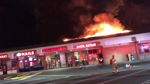 Firefighters work to contain raging fire at Valley Plaza shopping center in Puyallup