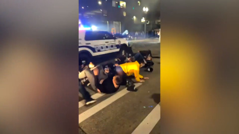 Tacoma, Wash., police car drives through crowd of pedestrians gathered at downtown street race