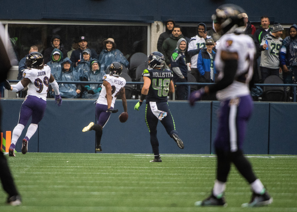 Ravens blitzes, Seahawks' inconsistent run game create Russell Wilson's day to forget