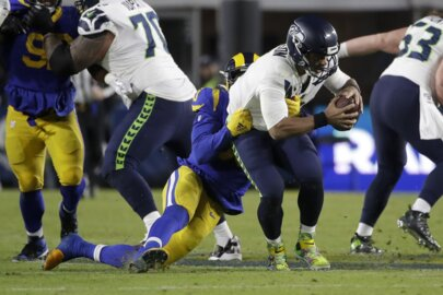 Russell Wilson: 18 sacks in 4 games. Pete Carroll: Seahawks QB often needs to get ball out