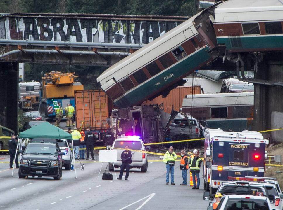 Amtrak engineer possibly distracted before speeding train derailed, officials say