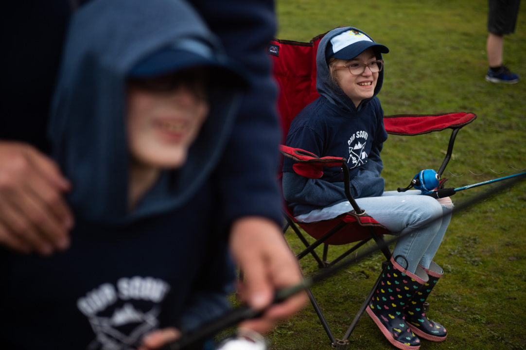 They're twins. He's blind, she's not. For the first time, they're both Cub Scouts.