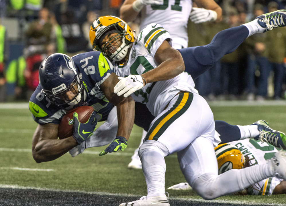 d0495831 From booed to brilliant: Russell Wilson rallies Seahawks past Packers,  Rodgers | Tacoma News Tribune