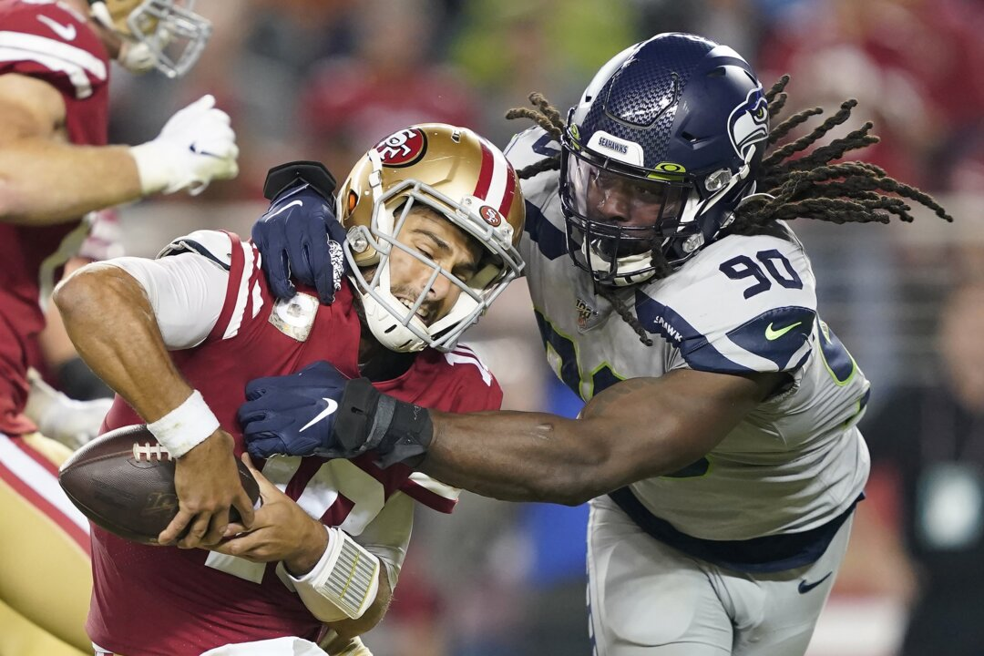 Jadeveon Clowney 'off campus' for treatment, yet signs are he'll play; Seahawks make moves