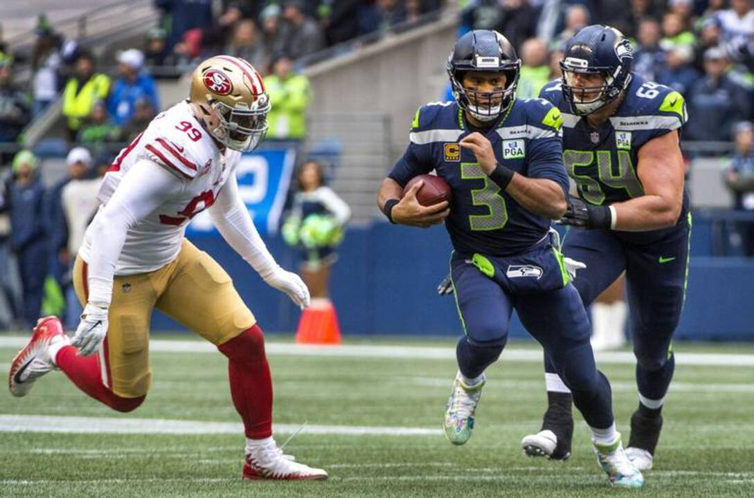 62b911c2 Russell Wilson has never passed as efficiently as he is now--because of how Seahawks  run | Tacoma News Tribune