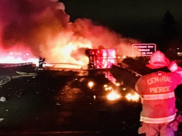 Semi truck rolled and burst into flames on SR 512 in Parkland, snarling traffic