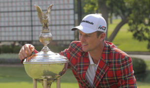 Fort Worth Invitational winner Justin Rose collects his winnings