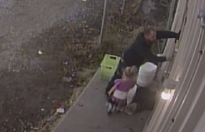 Burglar brought a little girl along for some breaking and entering, video shows