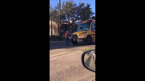 'He was begging him to let him in.' On video, Dallas ISD bus moves toward student in road.
