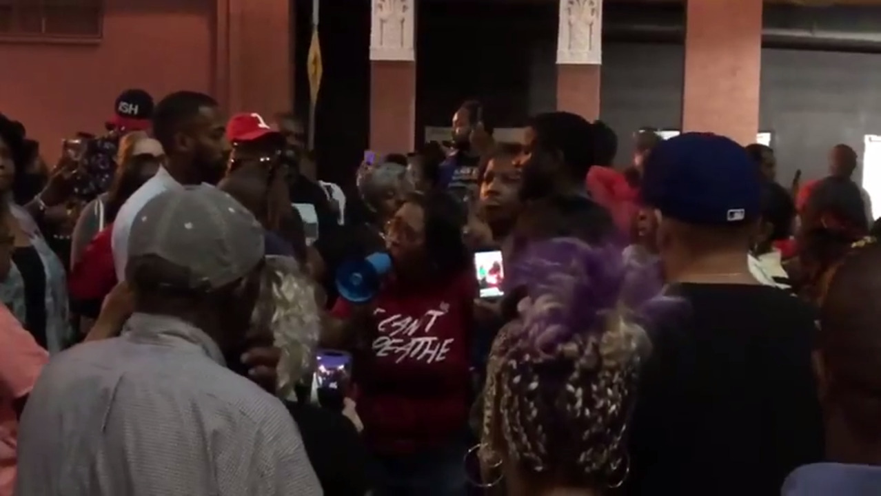 Crowd gathers to protest shooting death of Botham Jean