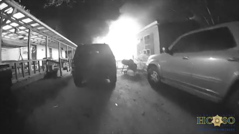 Texas deputy busts out windows searching for woman in burning trailer, bodycam shows
