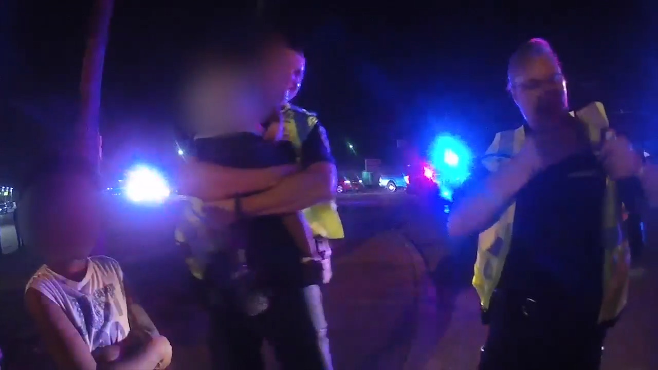 Watch cops smash window to rescue Texas baby and family in flipped car