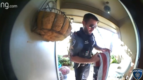 Southlake police officer folds flag brought down by storm