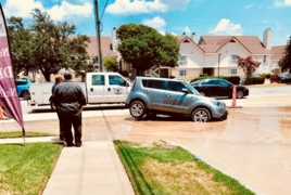 An SUV runs into a sinkhole in Fort Worth