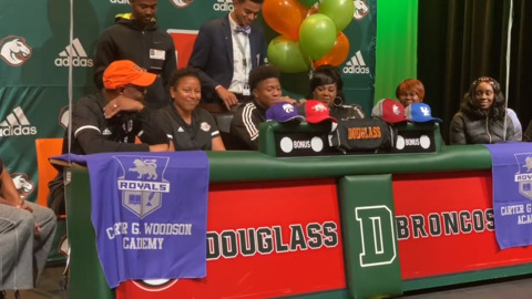 Douglass' Christian Lewis makes his college choice on signing day.
