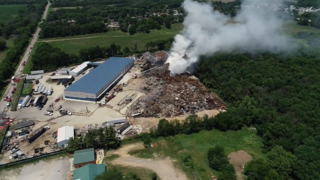 Stubborn recycling center fire continues into a second day