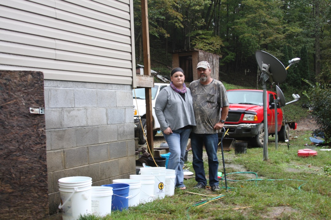'Set the buckets out.' A family of 7 prays for rain as a mountain water system crumbles.