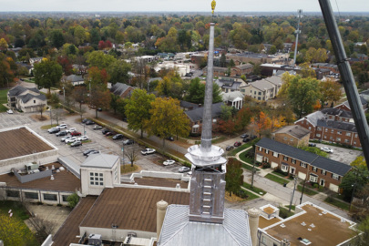Aerial video: A new spire is installed atop the Cathedral of Christ the King