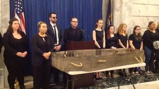 Here lies higher education. Students hold funeral in Capitol.