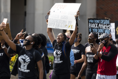 UK women's basketball team marches for equality