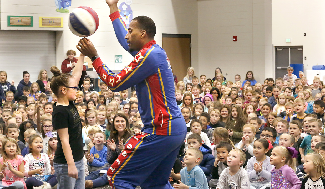 He may be 6-foot-8 but he's all ears. This Harlem Globetrotter is on a mission