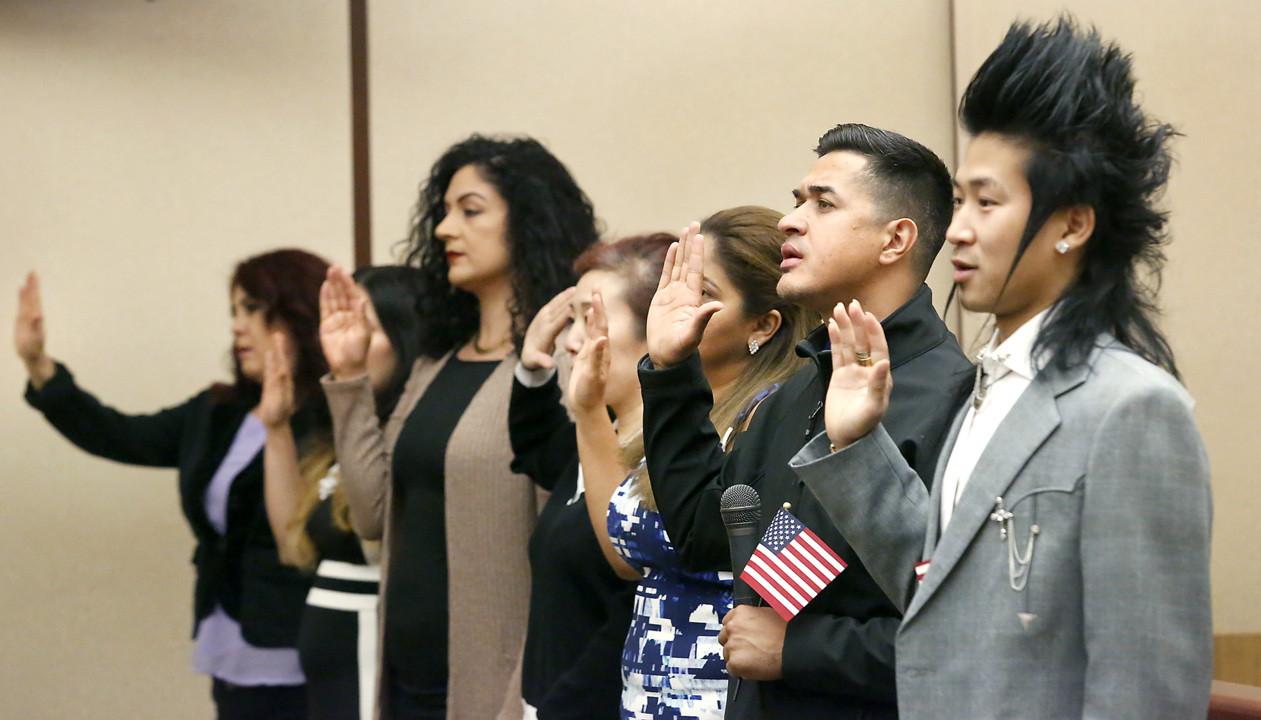 Local immigrants take Oath of Citizenship on Constitution
