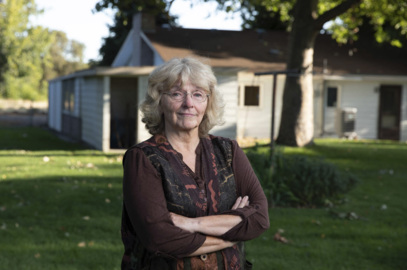 This widow wants to add a 2nd bedroom. Richland says she must widen the street too