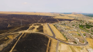 Video shows an aerial view of Kennewick after the fires come close to burning down homes