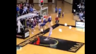 Player is shoved into goal after dunk