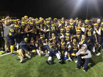 Northwest claims sectional championship with 35-18 victory over rival Bishop Carroll