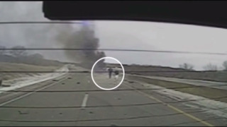 Watch a Kansas trooper rescue a man from a burning semi truck