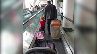 Mother of 2 was worried she'd get kicked off her flight, then a kind stranger came to the rescue