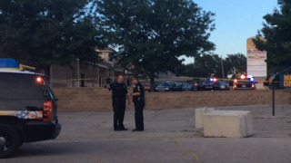 Man shot in car blocks from police station, Wichita State