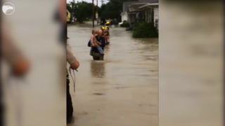 WATCH: First responders in Hays help family evacuate home in nearly waist-high water
