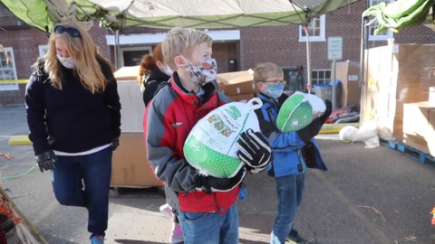 """There is no joy like giving."" Boise Rescue Mission turkey giveaway"