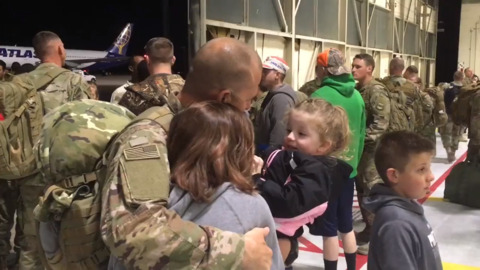 Hugs, tears and love await returned Air Force squadron in Mountain Home