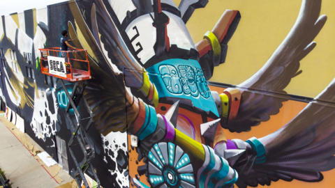 Quetzalcoatl emerges from mural on Hispanic Cultural Center of Idaho building