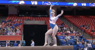 Gymnast busts out moonwalk in the middle of her beam routine