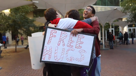 Timberline students give free hugs. Warning: It's contagious
