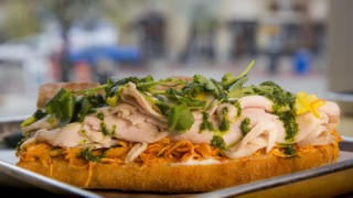 Tasso offers up a menu of globally-inspired sandwiches, salads and happy hour fare