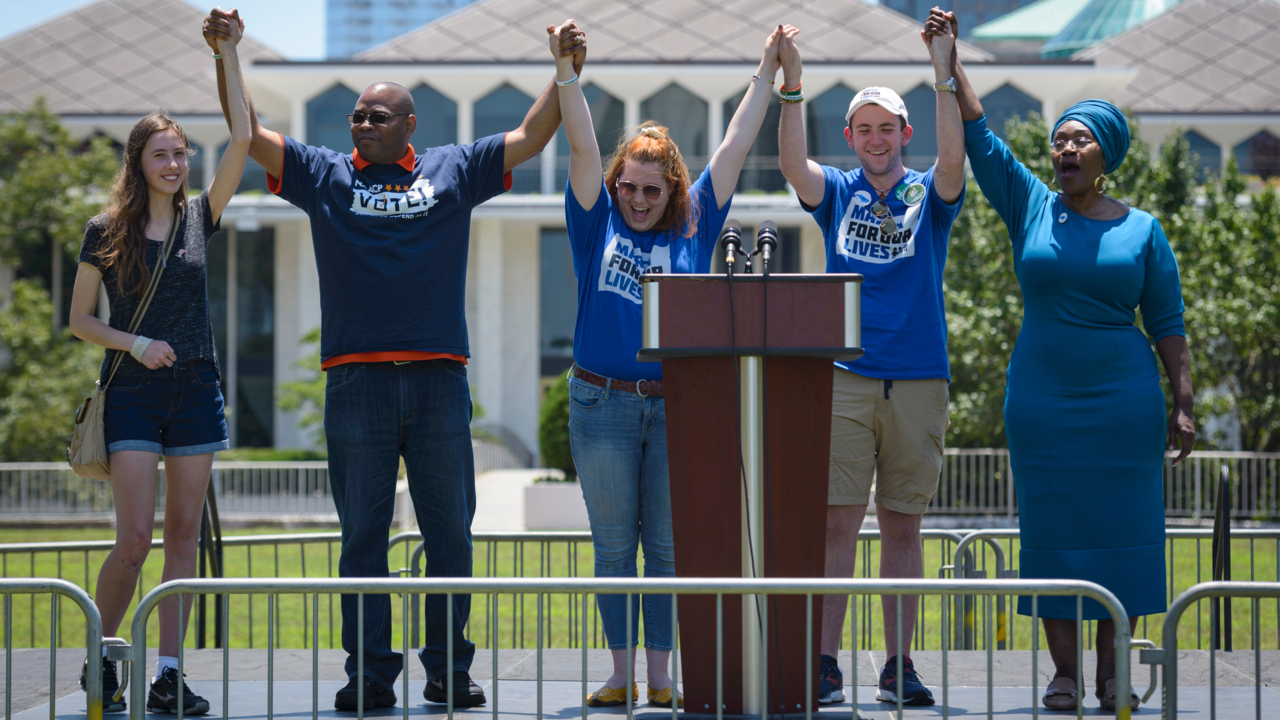 UNC Charlotte students, supporters raise gun violence questions, call others to action