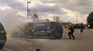 Good Samaritans flip a burning car to free a trapped driver