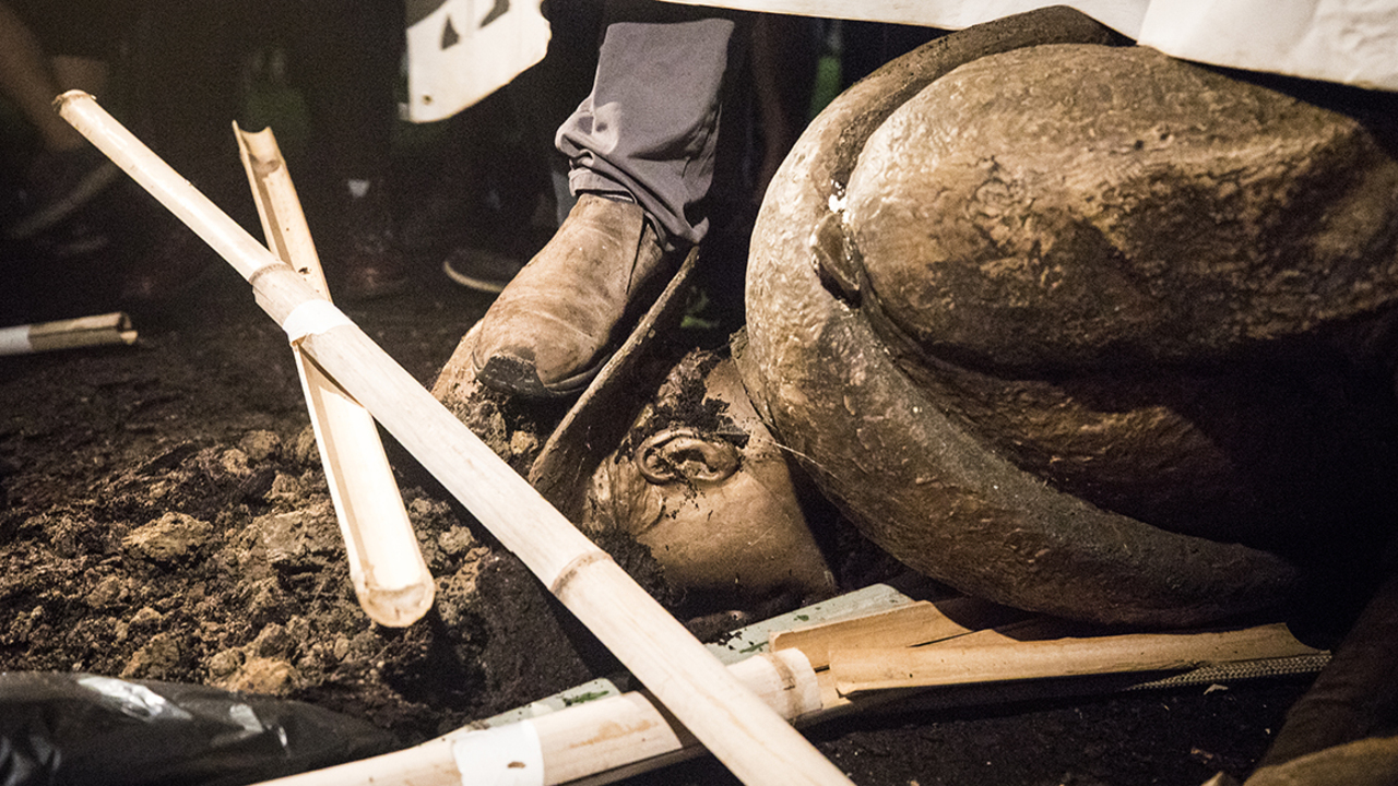 Activists gather at UNC-Chapel Hill to celebrate the fall of the Silent Sam statue