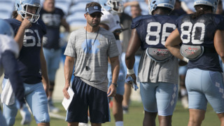 Who impressed UNC coach Larry Fedora in their first scrimmage ?